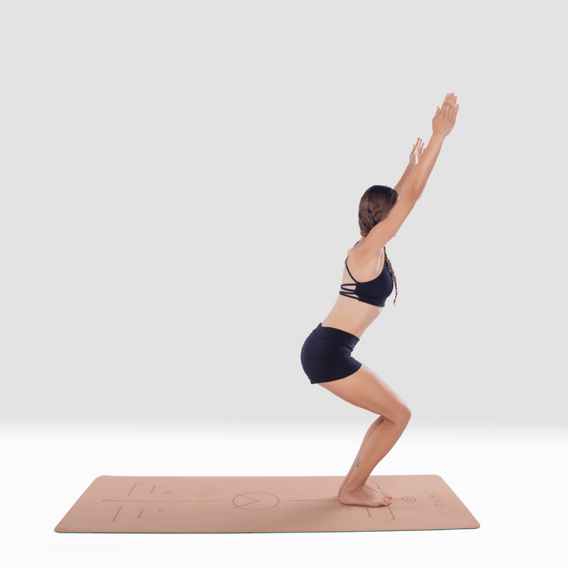 Woman practicing on ZONE Cork Yoga Mat in chair pose