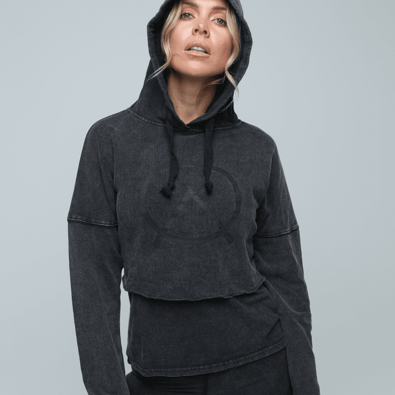 Woman wearing sustainable hemp Cropped Hoodie  layered with muscle tee in vintage black