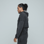 Side view of man wearing Zone by Lydia hemp Cropped Hoodie layered with hemp muscle tank and joggers in vintage black