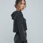 Woman side on wearing Zone by Lydia hemp Cropped Hoodie and jogger in vintage black
