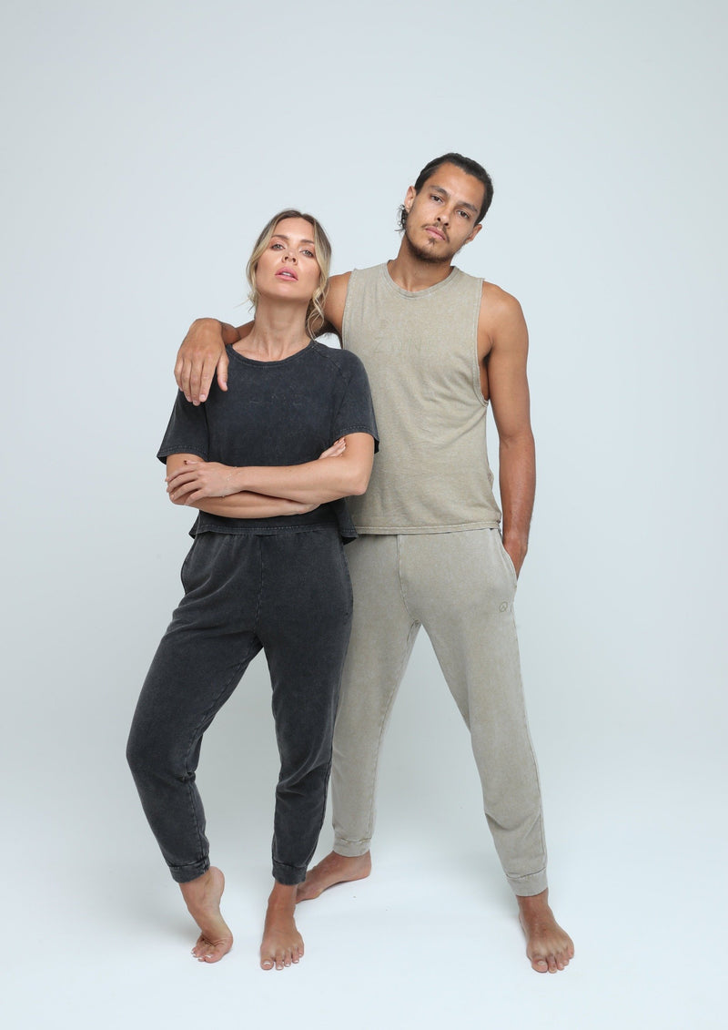 Male and female model wearing sustainable Zone By Lydia hemp yoga streetwear in vintage black and sand