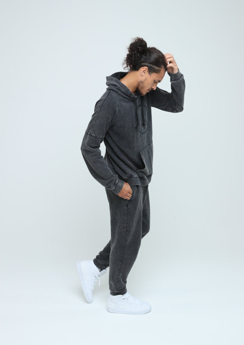 Male model wearing comfortable and sustainable gender neutral Hemp jogger and oversized hoodie in vintage black