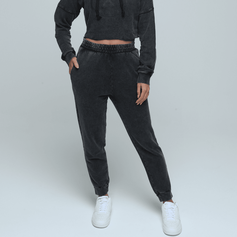 Woman wearing comfortable, stylish and sustainable gender neutral Hemp joggers in vintage black