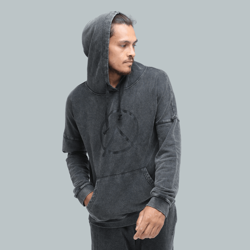 male wearing sustainable hemp Oversized Hoodie in vintage black