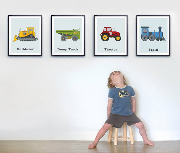 toddler boy with four truck prints