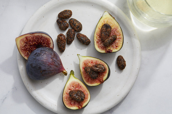 Fresh, Ripe Figs Halved and Quartered with Cinnamon-Spiced Caramelized Cacao Beans and white wine