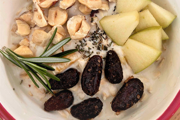 Oatmeal Breakfast Bowl with Apple, Cacao, Hazelnuts, and Rosemary Recipe