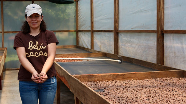 Belu Cacao - Emily with dried, fermented cacao in drying center, El Salvador