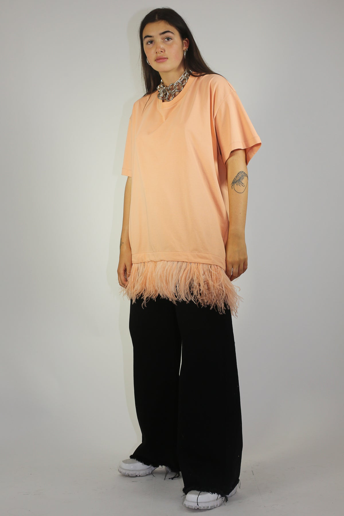 FEATHER HEM TOP IN PINK