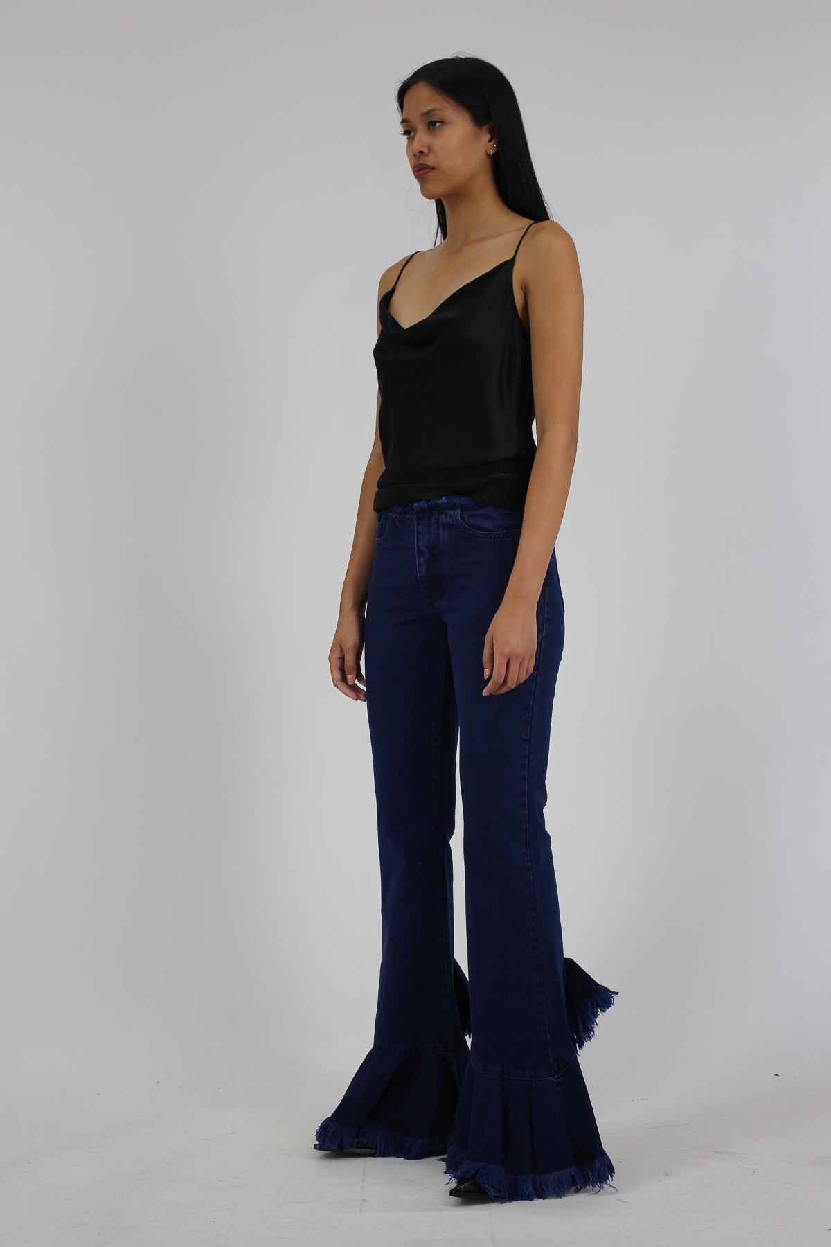 PRE-OWNED / FLARED JEANS WITH ASYMMETRIC FRILL