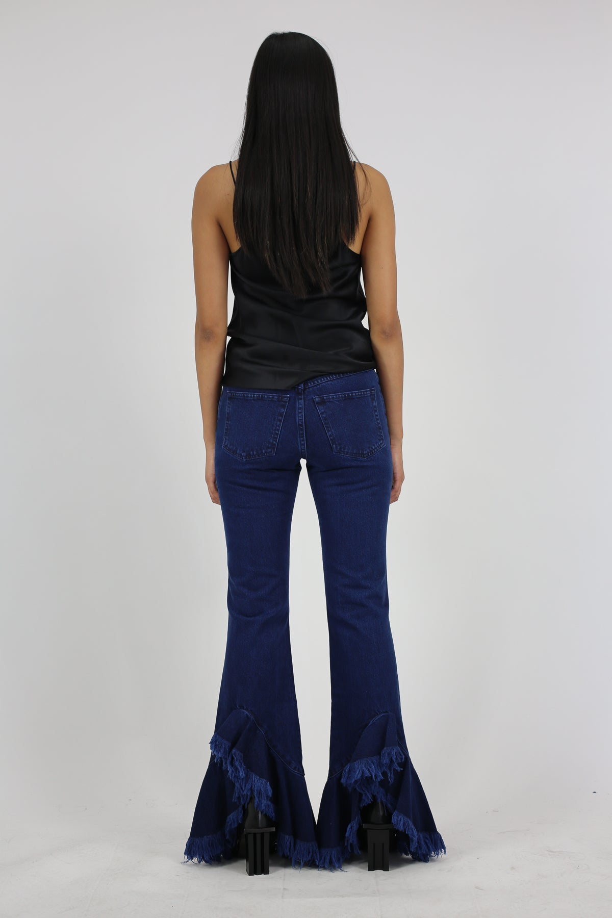 PRE-OWNED / FLARED JEANS WITH ASYMMETRIC FRILL - marques-almeida-dev