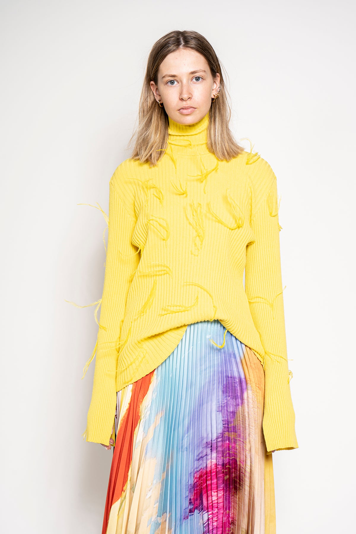 TURTLENECK JUMPER WITH FLARED SLEEVES IN YELLOW