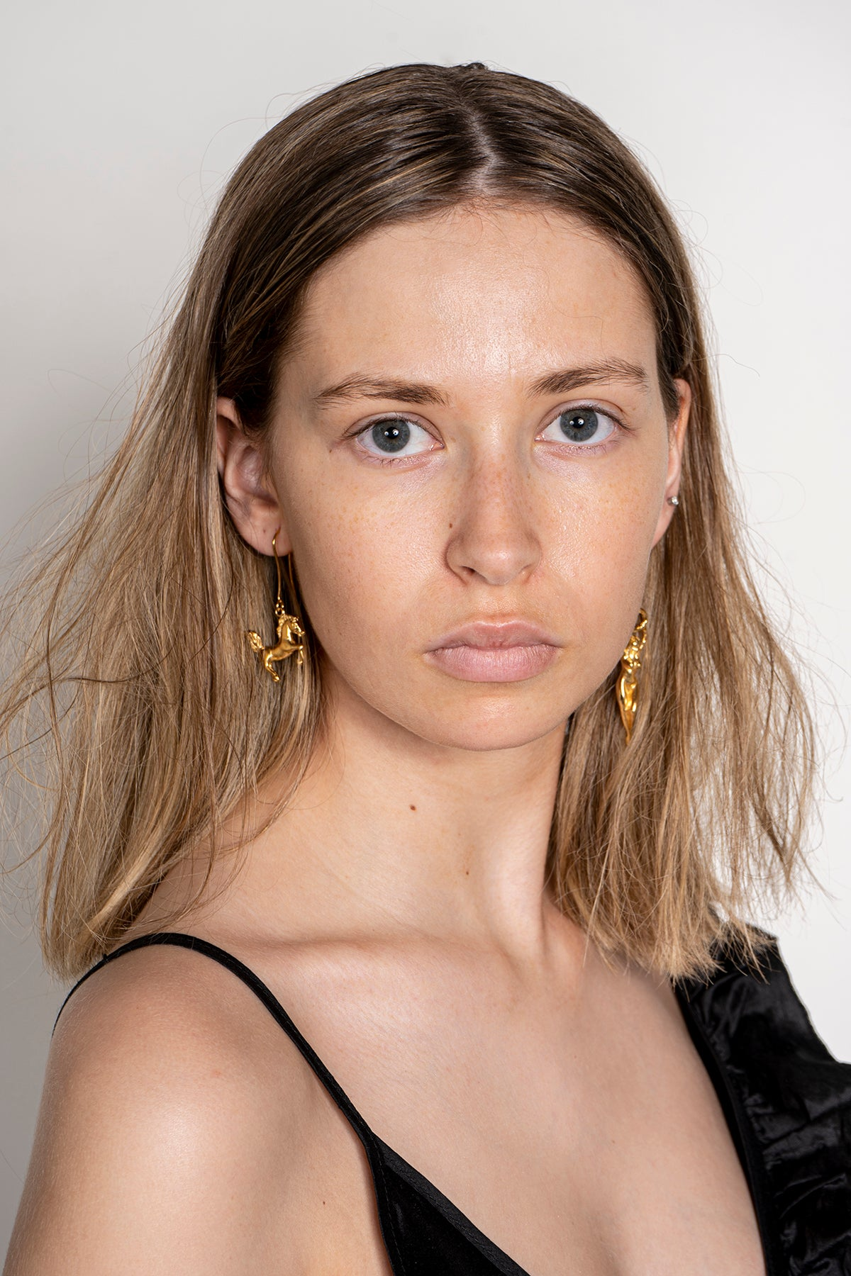 GOLD LADY AND HORSE EARRINGS