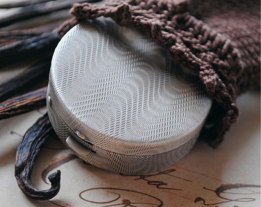 Figure 10: Blanc Solid Perfume in Round Compact with Pouch