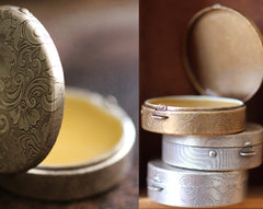 Figure 1: Noir Solid Natural Perfume Round Compact with Crochet Pouch