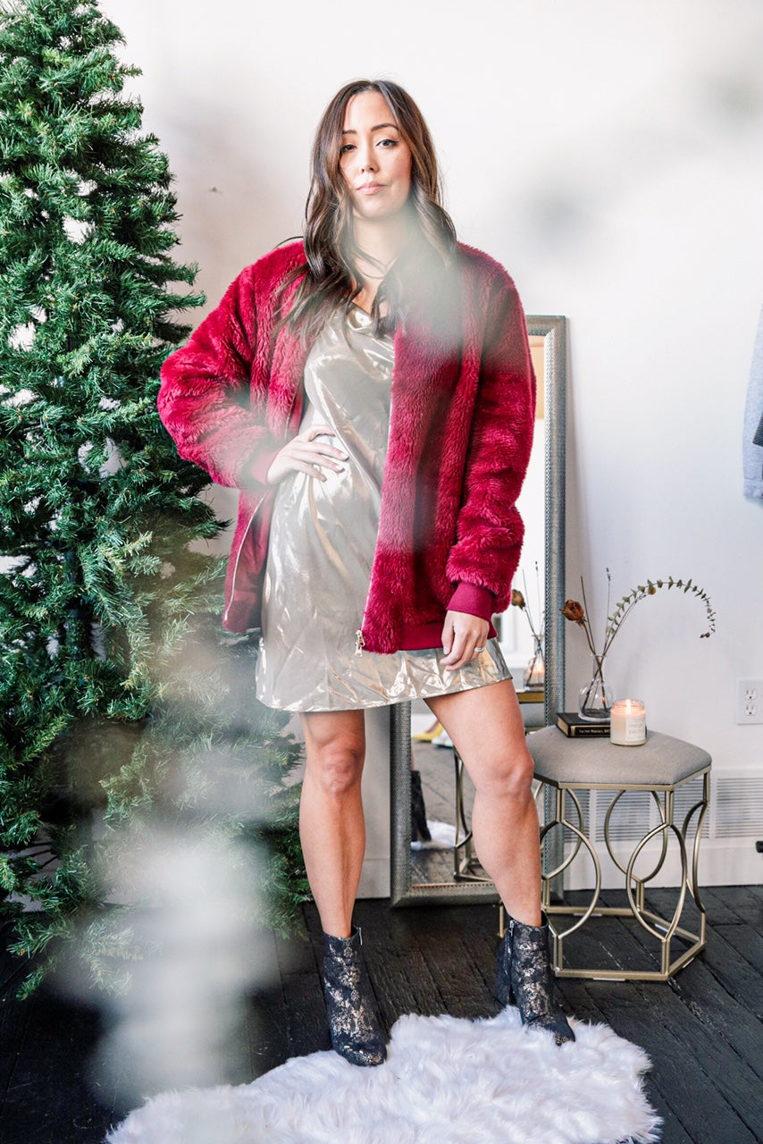 Champagne slip dress, red faux fur jacket and booties