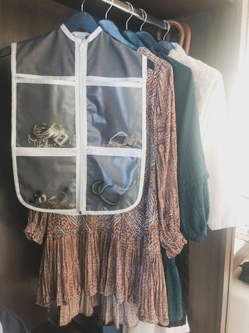 The Hanger Valet with outfits in hotel room