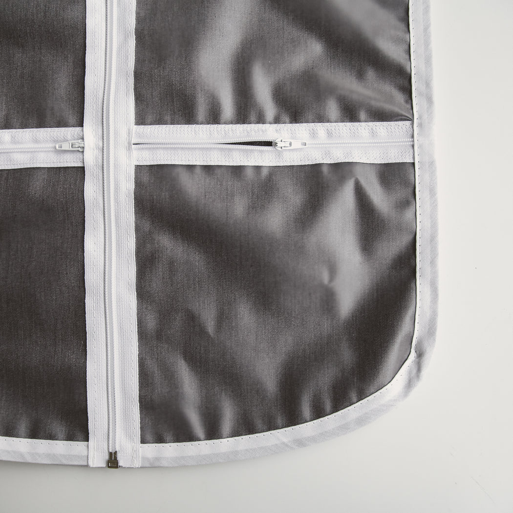 Detail of zippered pockets for accessories not the front of The Hanger Valet - adult size