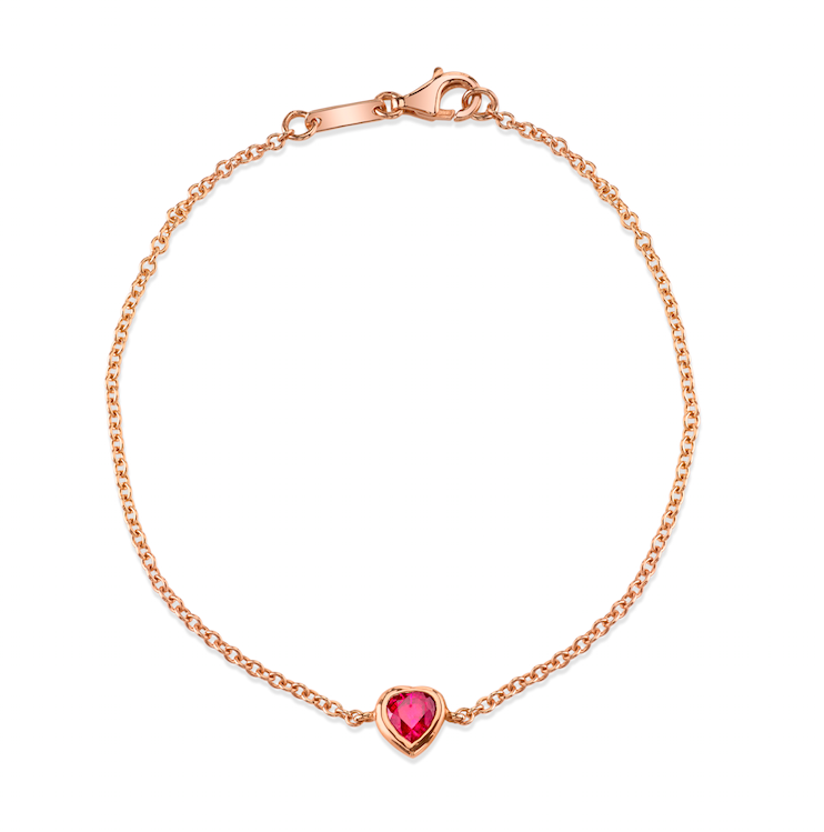 18k rose gold ruby heart shaped chain bracelet.