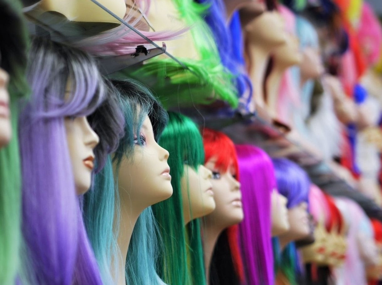 close up shot of display for fun costume party wigs at wig ave
