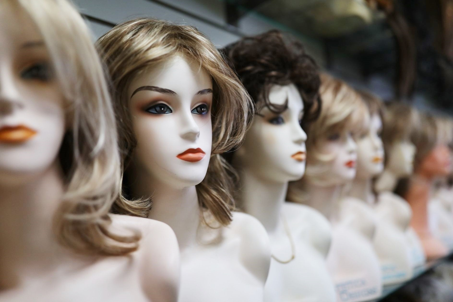 variety of wigs displayed at wig avenue in austin tx