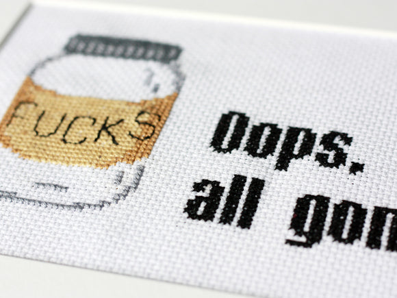 Funny cross stitch of a jar of fucks and the words oops all gone