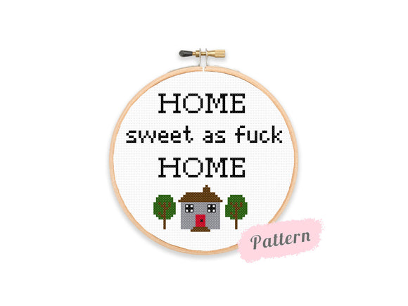 Cross stitch reading 'HOME sweet as fuck HOME' in black text with a house and two trees beneat