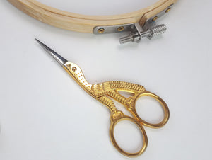 Small gold embroidery scissors shaped like a stork
