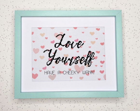 Love yourself cross stitch on white aida with pink heart pattern