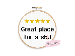 Cross stitch reading 'Great place for a shit' in black text below five yellow stars in the TripAdvisor style