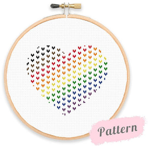 Cross stitch design of a heart shape made up of smaller hearts in the rainbow stripe colours of the Pride flag