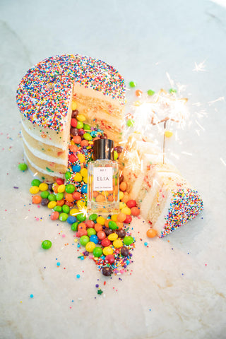 birthday perfume with a cake and sparklers