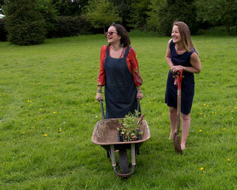 Jules and Caroline wheelbarrow where inspiration blooms