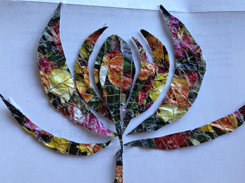 Flower made from stitched recycled magazine pages