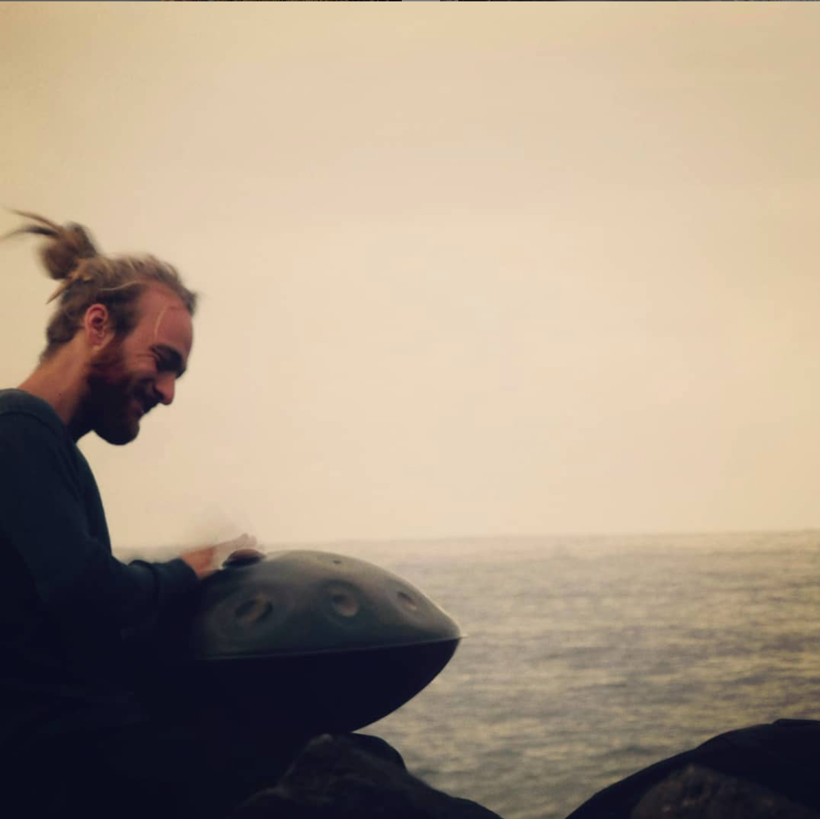 Handpan player Malte Marten of Yatao by the see