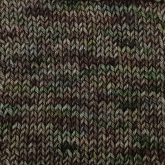 A dark green and brown variegated yarn knit in a stockinette stitch square