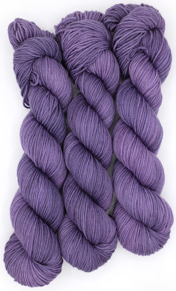 Dusty lilac indie dyed tonal yarn with darker lavender accents inspired by the work of Edward Gorey