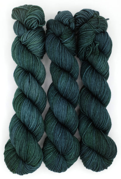 Bottle green indie dyed tonal yarn inspired by the ominously menacing shrubbery in Edward Gorey's work.