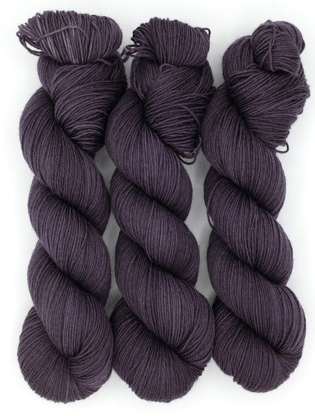 A semi-solid indie dyed yarn in a rich, dark eggplant purple inspired by the work of Edward Gorey