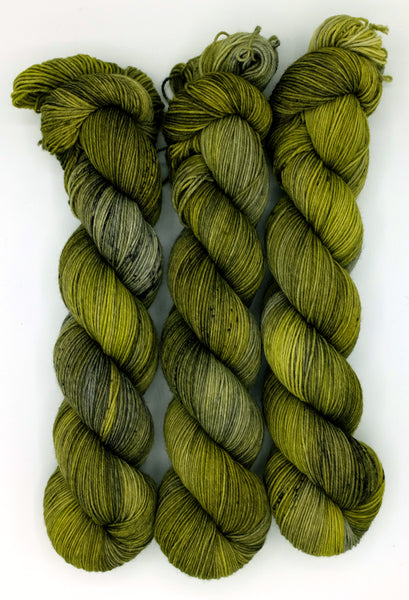 Slime green indie dyed tonal yarn with platinum undertones, speckled with black and inspired by the fly-munching Refield from Bram Stoker's Dracula.