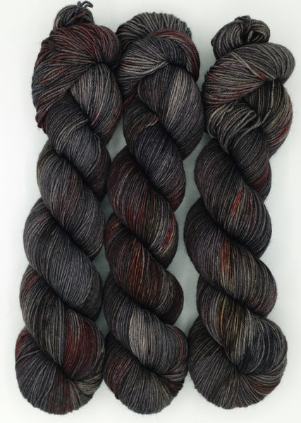 Grey and black indie dyed yarn speckled with blood red and earthy sienna - inspired by the Bram Stoker novel, Dracula.