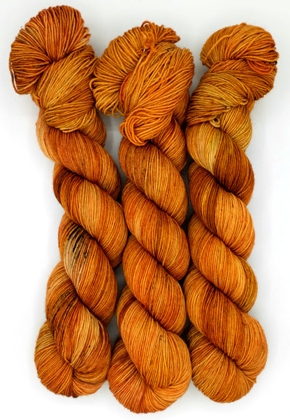 A firey orange indie dyed yarn with darker rust and saffron speckles inspired by Ray Bradbury's classic ode to books, Fahrenheit 451.