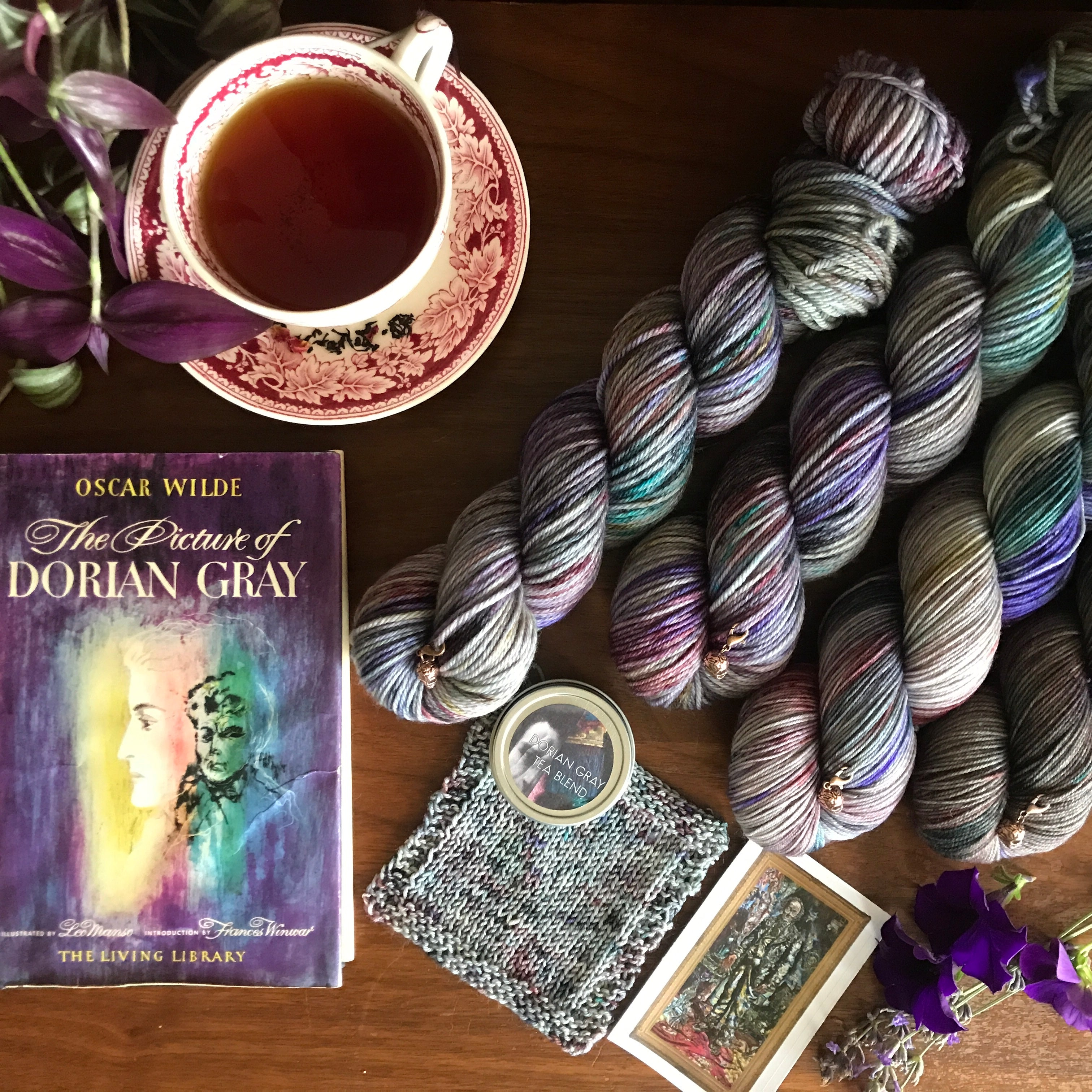 Yarn club inspired by The Picture of Dorian Gray features a floral-gray hand dyed yarn, rose petal infused tea, and skull progress keeper.