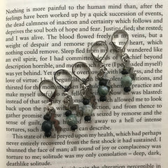 Six handmade stitch markers with jade beads and lightning bolts