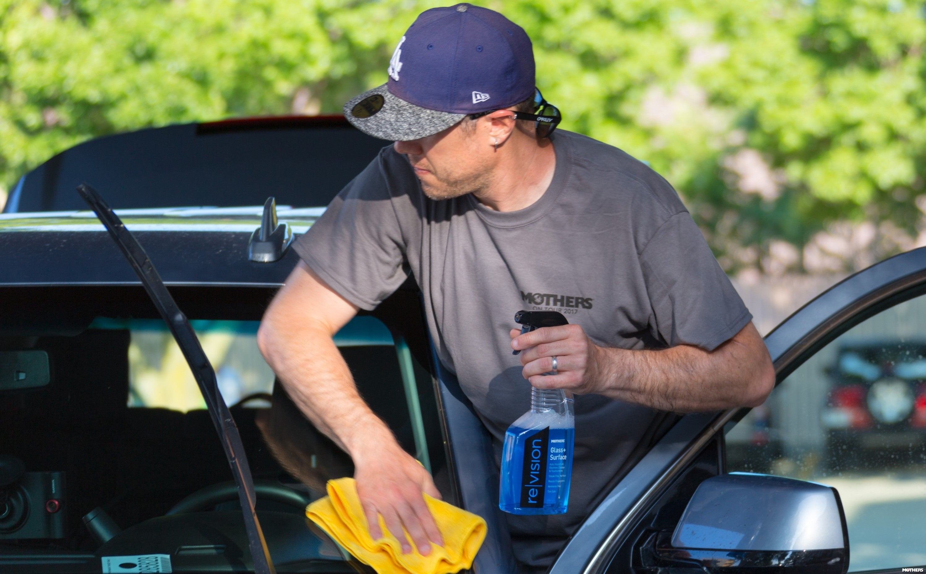 a man polishing a car