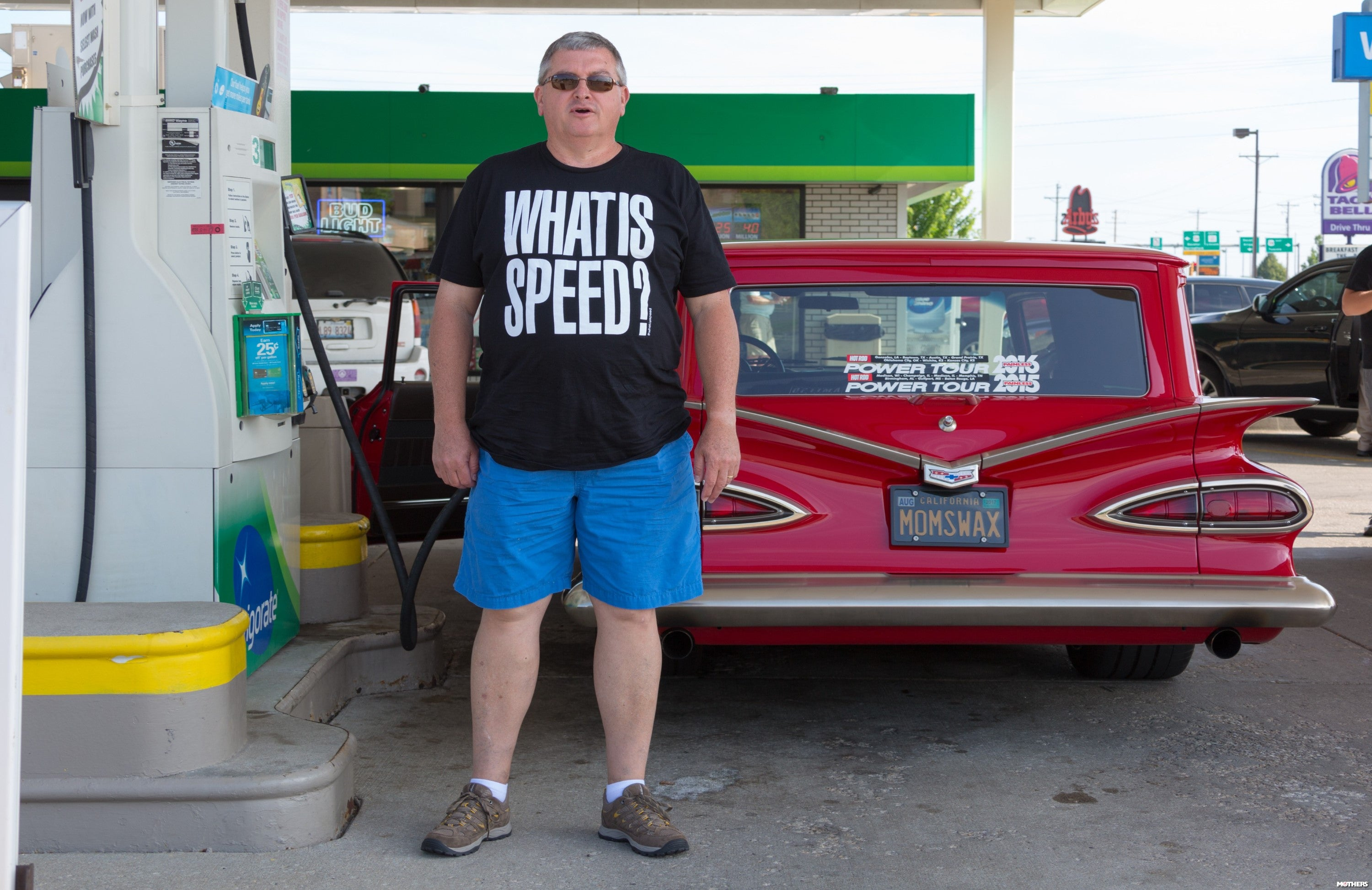 "a man wearing a shirt that says ""what is speed"""