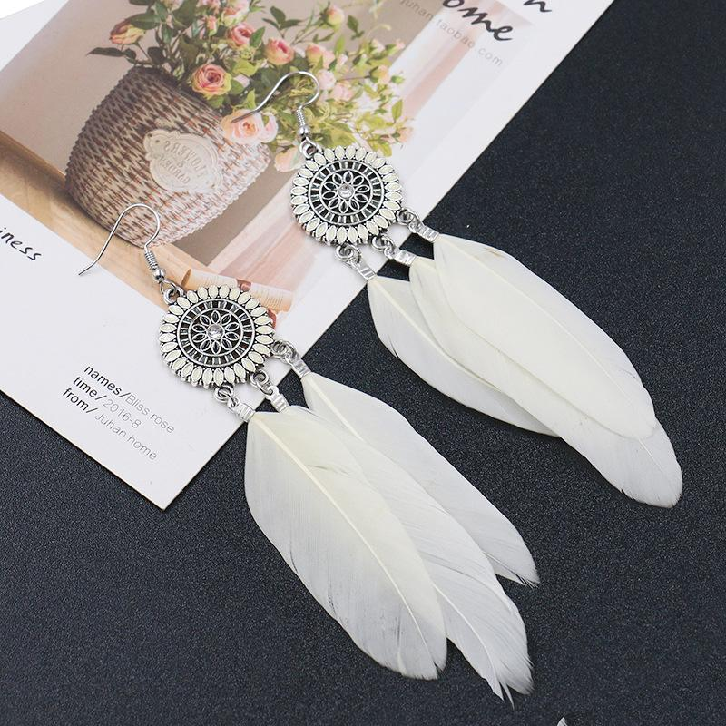 Fashion round flower ethnic retro tassel feather pendant long section earrings