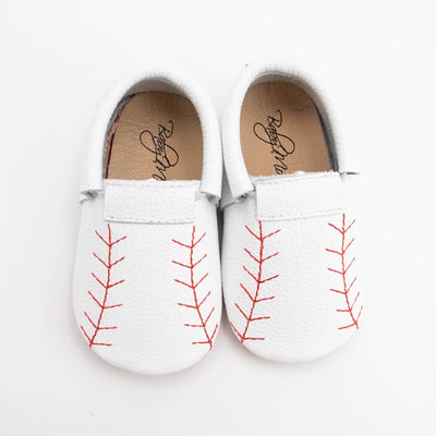 The perfect baseball shoes for the baseball loving babe in your life! White moccasins with red baseball styled stitching.