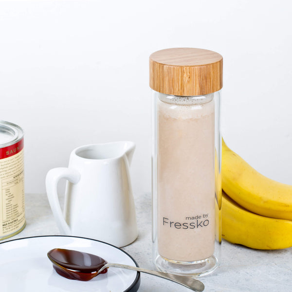 Banana malt smoothie in a glass fressko flask