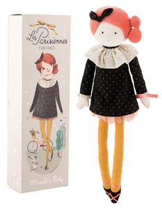 Madame Constance is oh-so-elegant, dressed in a floaty black cotton sequined dress, complete with ruffs and tulle frills, with bar shoes and beautiful braids in her hair. She is presented in a gift box, decorated with a Paris theme. She measures 47cm.
